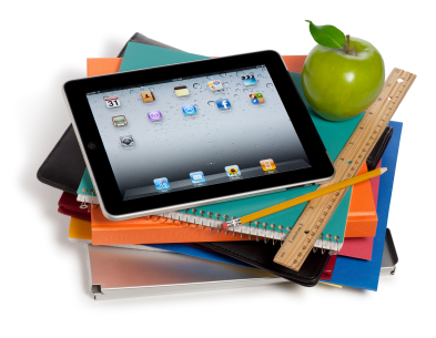 Picture of an Ipad on top of some school books.