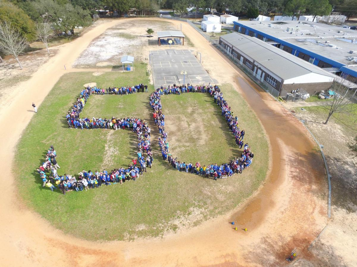 Picture of 50 spelled out by students