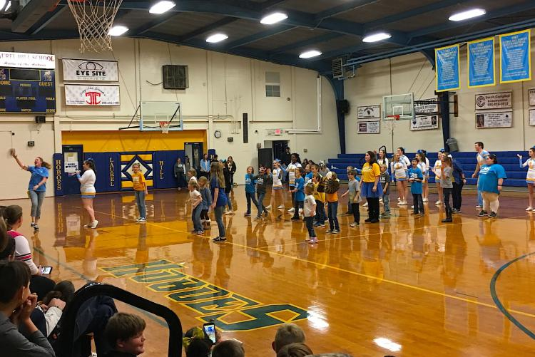 "The Laurel Hill School heritage evening began with a show of school spirit as cheerleaders and representatives of each Hobo House performed ""This is the Greatest School."""
