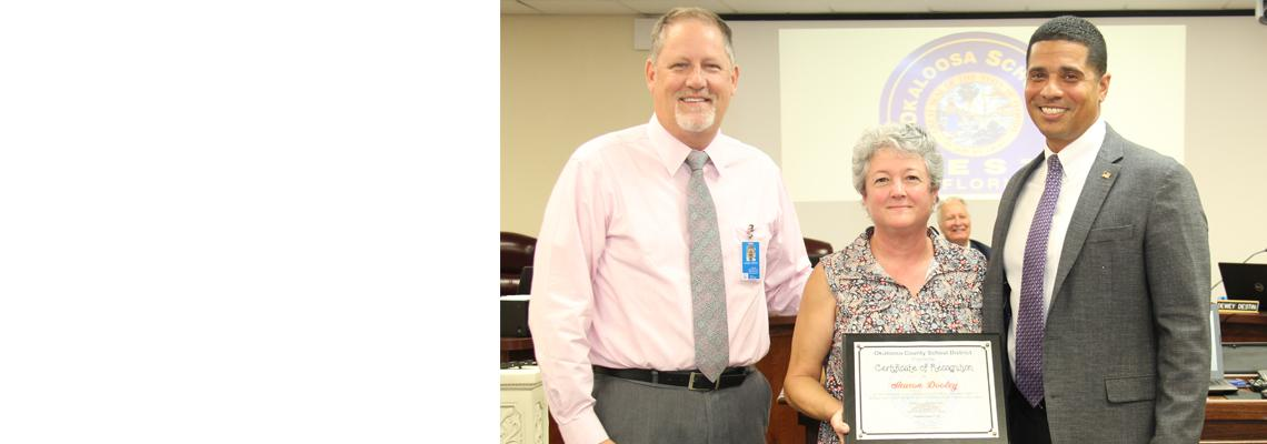 Sharon Dooley, NWFDN, pictured with Superintendent Marcus Chambers and Assistant Superintendent Steve Horton